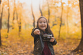 Surprised child girl using an old-fashioned camera in autumn nature. Photographer, fall season and - PhotoDune Item for Sale