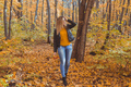 Cute smiley woman holding autumn leaves in fall park. Seasonal, lifestyle and leisure concept - PhotoDune Item for Sale