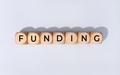 Funding word on wooden block - PhotoDune Item for Sale