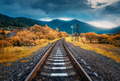 Rural railroad in mountains in overcast day. Old railway - PhotoDune Item for Sale
