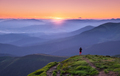 Alone man on the mountain peak looking on mountain valley in fog - PhotoDune Item for Sale