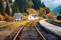 Railway station and white house in mountain village at sunset - PhotoDune Item for Sale