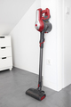 Cordless vacuum cleaner leaning on a wall - PhotoDune Item for Sale