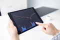 Woman holding a digital tablet with stock market chart - PhotoDune Item for Sale