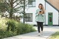 Modern Woman Walking Outdoors - PhotoDune Item for Sale