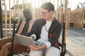 Young Man And Woman Working On Business Plan - PhotoDune Item for Sale
