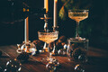 Christmas background with candles and glasses of champagne. - PhotoDune Item for Sale