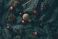 Christmas tree branches and festive decoration on wooden background. - PhotoDune Item for Sale