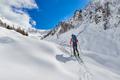 Girl makes ski mountaineering uphill alone - PhotoDune Item for Sale