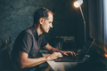 Man working at home using laptop, male working in modern studio - PhotoDune Item for Sale