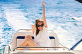 Happy young woman on a yacht - PhotoDune Item for Sale
