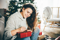 Woman wrapping Christmas gifts at home. Packing of the Christmas presents. - PhotoDune Item for Sale