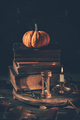 Still life for Halloween and Thanksgiving with old books, pumpkins and candle - PhotoDune Item for Sale