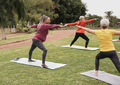 Multiracial women doing yoga exercise with social distance for coronavirus outbreak at city park - PhotoDune Item for Sale