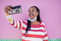 Senior african woman talking on a video call with smartphone in the city - PhotoDune Item for Sale