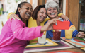 Multiracial senior women taking a selife using mobile phone at bar outdoor - PhotoDune Item for Sale