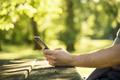 Using smartphone in park - PhotoDune Item for Sale