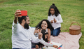 Happy indian family enjoy day outdoor at park with picnic and toys while taking a selfie - PhotoDune Item for Sale