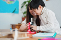 Asian mother and child having playful time with microscope toy - PhotoDune Item for Sale