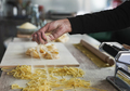Woman working inside pasta factory - Fresh made taditional italian pasta - PhotoDune Item for Sale