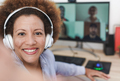 Multiracial mature woman taking a selfie with video call people in background - PhotoDune Item for Sale