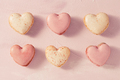 Delicious French macarons in heart shape on pink background - PhotoDune Item for Sale