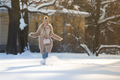 Trendy young woman happy enjoy walking outside on sidewalk covered with snow on sunny winter day - PhotoDune Item for Sale