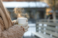 Woman drink tea or coffee walking city on frosty winter day. Hands in mittens holding steaming cup - PhotoDune Item for Sale
