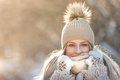 Winter outdoor portrait of young woman in warm hat, knitted mittens and scarf walking in snowy park - PhotoDune Item for Sale