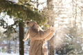 Excited woman play with snow in winter park. Cheerful young female enjoy wintertime weather outdoor - PhotoDune Item for Sale