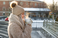 Young girl in faux fur coat drink tea after skating on ice rink enjoy walk outdoors and fresh coffee - PhotoDune Item for Sale