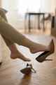 Cropped image of tired woman take off high heels shoes sit barefoot in living room with no footwear - PhotoDune Item for Sale