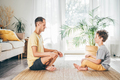Father and son meditating at home. - PhotoDune Item for Sale