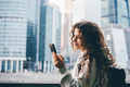 Young woman holds smartphone - PhotoDune Item for Sale