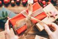 Woman preparing presents for Christmas. - PhotoDune Item for Sale