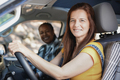 Multiracial mature women on a road trip with mini van camper while smiling on camera - PhotoDune Item for Sale