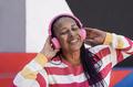 African american senior woman dancing to music playlist wearing wireless headphone - PhotoDune Item for Sale
