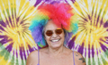 Old woman wearing colorful wig and hippie sunglasses smiling on camera - PhotoDune Item for Sale