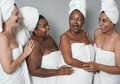 Multiracial women having fun doing beauty day together - PhotoDune Item for Sale