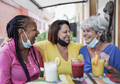 Senior women having fun drinking healthy smoothie together in the city at bar terrace - PhotoDune Item for Sale