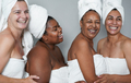 Multiracial women embracing together inside beauty studio while doing spa day - PhotoDune Item for Sale