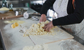 Woman kneading dough for fresh made gnocchi inside pasta factory - PhotoDune Item for Sale