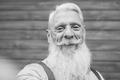 Hipster senior man taking a selfie - Old person enjoy technology - PhotoDune Item for Sale