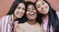 Multiracial young women with different skin color smiling on camera - PhotoDune Item for Sale