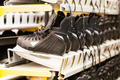 Rows of black ice skates, selective soft focus. Hire of winter sports equipment - PhotoDune Item for Sale