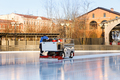 ice preparation at the rink between sessions in the sunny winter day/ Polished ice ready for match - PhotoDune Item for Sale