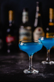 Blue cocktail / wine / champagne on a dark table - PhotoDune Item for Sale