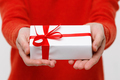 Man holds gift forward in his hand, close up - PhotoDune Item for Sale