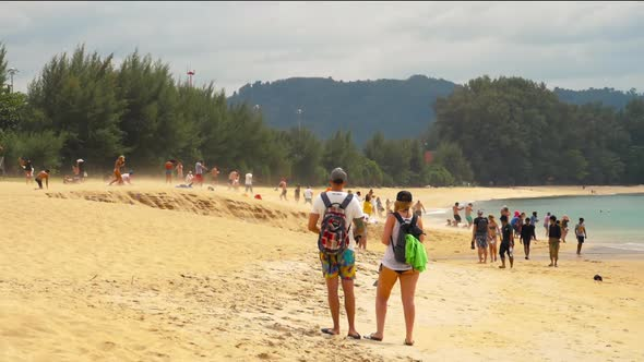 Onlookers on the Beach Watching Aircrafts Departing at Phuket Airport.