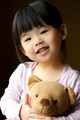 Smiling little child with a teddy bear - PhotoDune Item for Sale